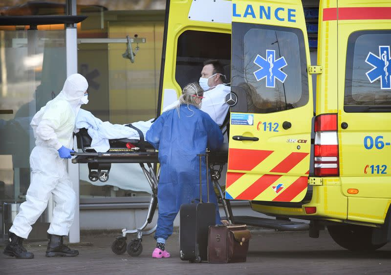 FILE PHOTO: Dutch health workers leave with a patient at Bernhoven hospital, as the spread of coronavirus disease (COVID-19) continues, in Uden