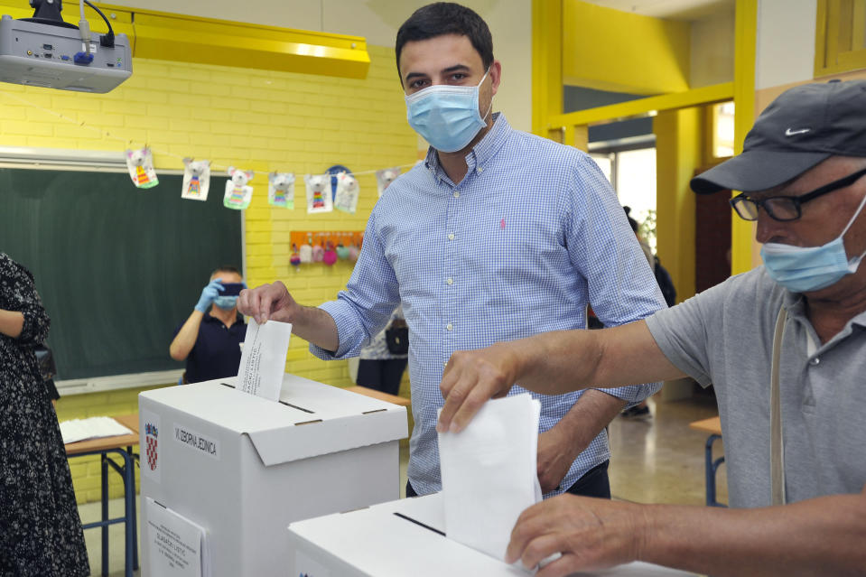 Davor Bernardic, leader of the Restart coalition casts his ballot at a polling station in Zagreb, Croatia, Sunday, July 5, 2020. Amid a spike of new coronavirus cases, voters in Croatia cast ballots on Sunday in what is expected be a close parliamentary race that could push the latest European Union member state further to the right. (AP Photo)