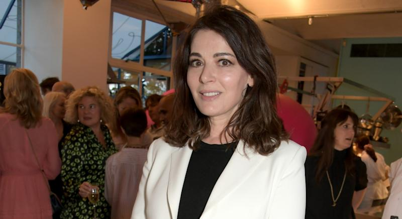 Nigella Lawson says she tries to spend six hours a day reading books on the weekends [Image: Getty]