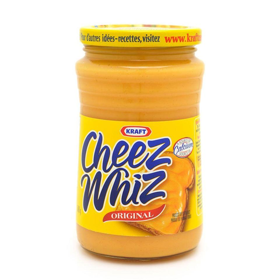<p>Developed by food scientist Edwin Traisman and sold by Kraft, Cheez Whiz became the processed, shelf-stable cheese sauce that everyone used to top hot dogs, chips, and more. </p>