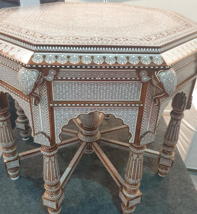 This table carved in Sheesham wood has over lakhs of depressions manually filled with acrylic material . A Hoshiarpur-based artist took six years to complete this masterpiece. (Photo: HuffPost India )