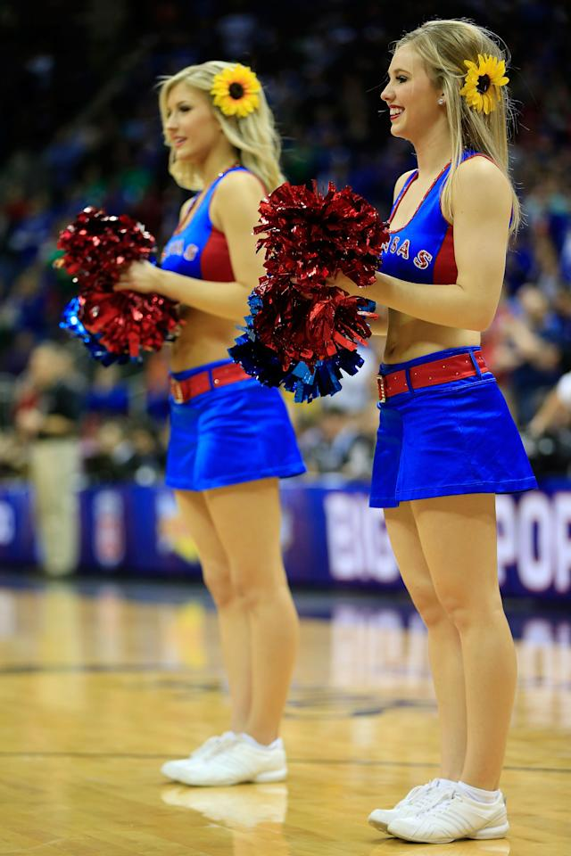 KANSAS CITY, MO - MARCH 16:  Members of the Kansas Jayhawks cheerleaders perform in the first half against the Kansas State Wildcats during the Final of the Big 12 basketball tournament at Sprint Center on March 16, 2013 in Kansas City, Missouri.  (Photo by Jamie Squire/Getty Images)