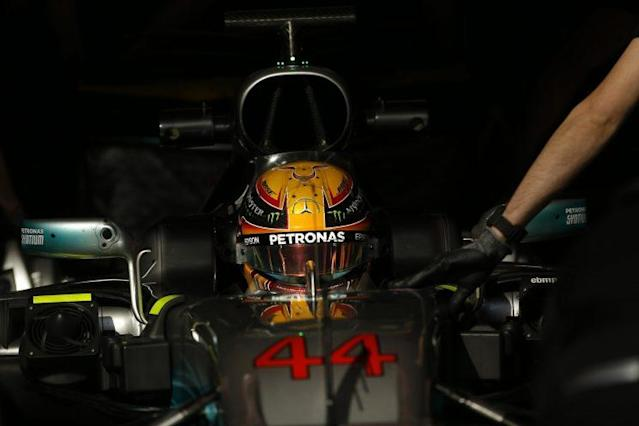 Mellow yellow: He may not have been fastest but Lewis Hamilton seemed happy with pre-season testing