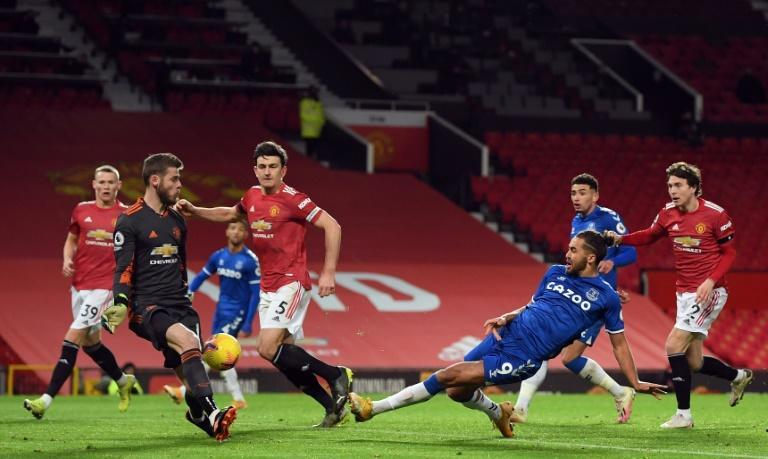 Stoppage time stunner: Dominic Calvert-Lewin (2nd right)slid in to score Everton's late equaliser against Manchester United