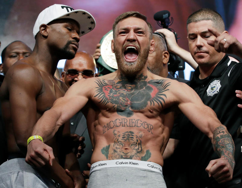 Conor McGregor: New York police charge UFC star following bus attack