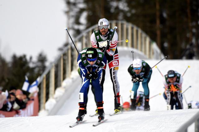 Lahti Ski Games - FIS Nordic Combined World Cup - Men's Gundersen - Lahti, Finland - March 4, 2018 - Eero Hirvonen of Finland and Lukas Greiderer of Austria compete. Lehtikuva/Markku Ulander/ via REUTERS ATTENTION EDITORS - THIS IMAGE WAS PROVIDED BY A THIRD PARTY. NO THIRD PARTY SALES. NOT FOR USE BY REUTERS THIRD PARTY DISTRIBUTORS. FINLAND OUT.