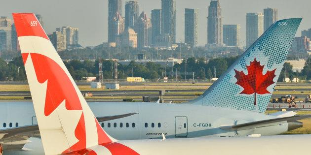 Air Canada planes at Toronto's Pearson International Airport, Wed. July 20, 2016. Airfares in many Canadian cities have dropped sharply, according to data compiled by airfares site Kayak.com.