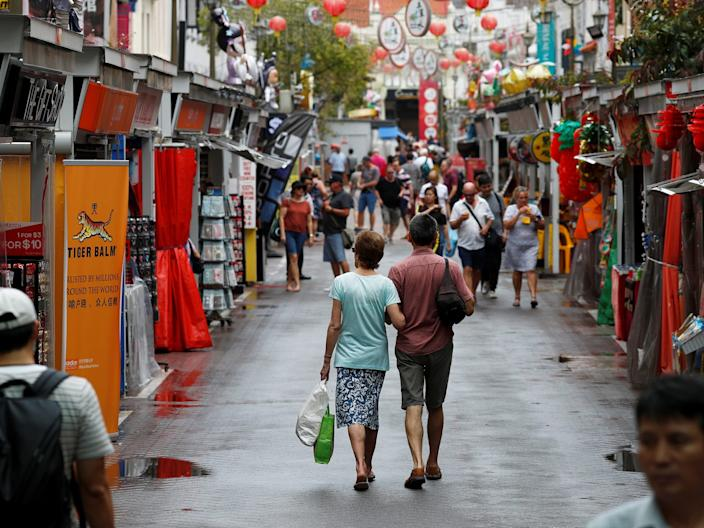 <br>Tourists walk in a largely empty Chinatown in Singapore on February 21, 2020.