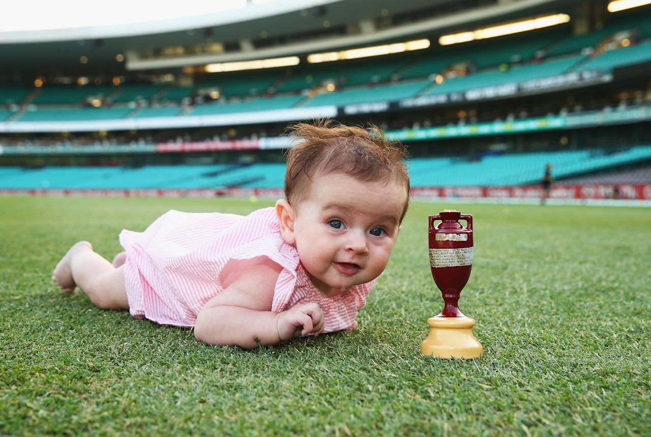 SYDNEY, AUSTRALIA - JANUARY 05:  Harper Lyon, daughter of Nathan Lyon of Australia poses with the urn after day three of the Fifth Ashes Test match between Australia and England at Sydney Cricket Ground on January 5, 2014 in Sydney, Australia.  (Photo by Ryan Pierse/Getty Images)