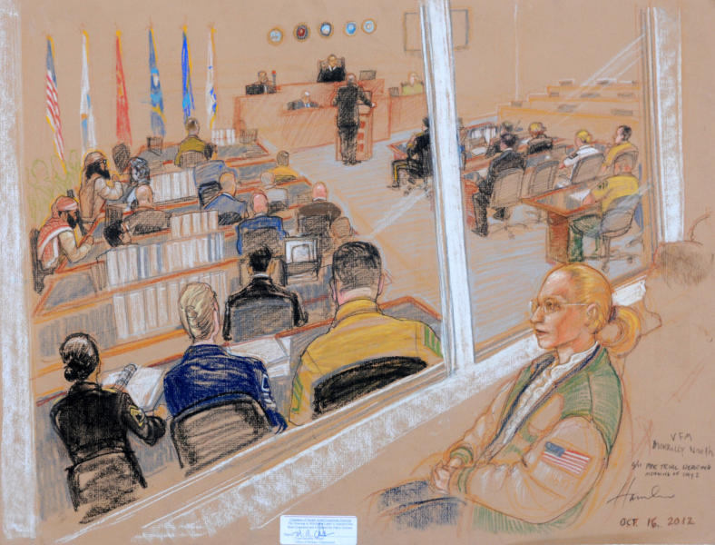 In this photo of a sketch by courtroom artist Janet Hamlin reviewed by the U.S. Department of Defense, Merrilly Noeth, a relative of a victim of the Sept. 11 attacks, watches behind sound-proof glass on the second day of the Military Commissions pretrial hearing against the five Guantanamo prisoners accused of the terrorist attacks at the Guantanamo Bay U.S. Naval Base in Cuba, Tuesday, Oct. 16, 2012. The military tribunal for the Sept. 11 terrorism case resumed Tuesday without three of the five defendants, the result of a judge's ruling that the men could not be forced to attend the session. Those who showed up in court were Yemenis Walid bin Attash and Ramzi Binalshibh. (AP Photo/Janet Hamlin, Pool)