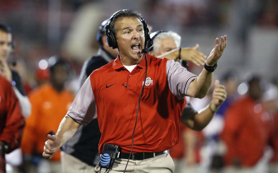 FILE - In this Sept. 17, 2016, file photo, Ohio State head coach Urban Meyer shouts from the sideline in the fourth quarter of an NCAA college football game against Oklahoma in Norman, Okla. The coaching staff at Rutgers knows the culture of the Ohio State football program as well as any opponent can. (AP Photo/Sue Ogrocki, File)