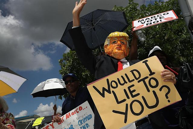 <p>Glenn Terry dressed as President Donald Trump joins with other protesters at U.S. Sen. Marco Rubio's (R-FL) office on June 28, 2017 in Doral, Florida. (Photo: Joe Raedle/Getty Images) </p>
