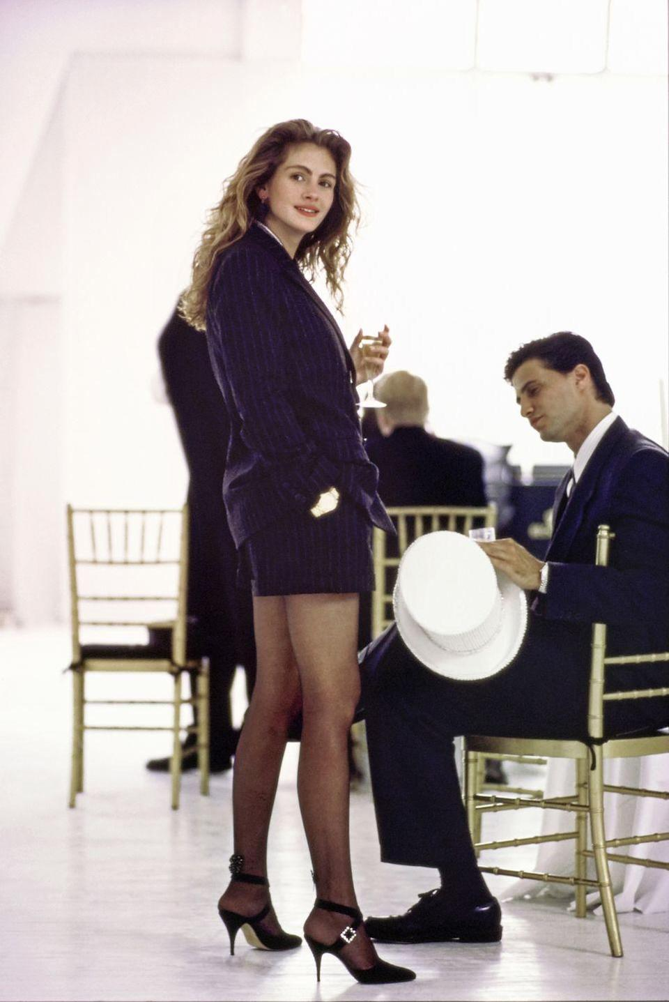 <p>Julia Roberts poses for a photoshoot in a pair of pinstripe dress shorts and a matching oversized blazer. Her older brother, Eric Roberts, is seen on the right, but he didn't get the shorts memo.</p>