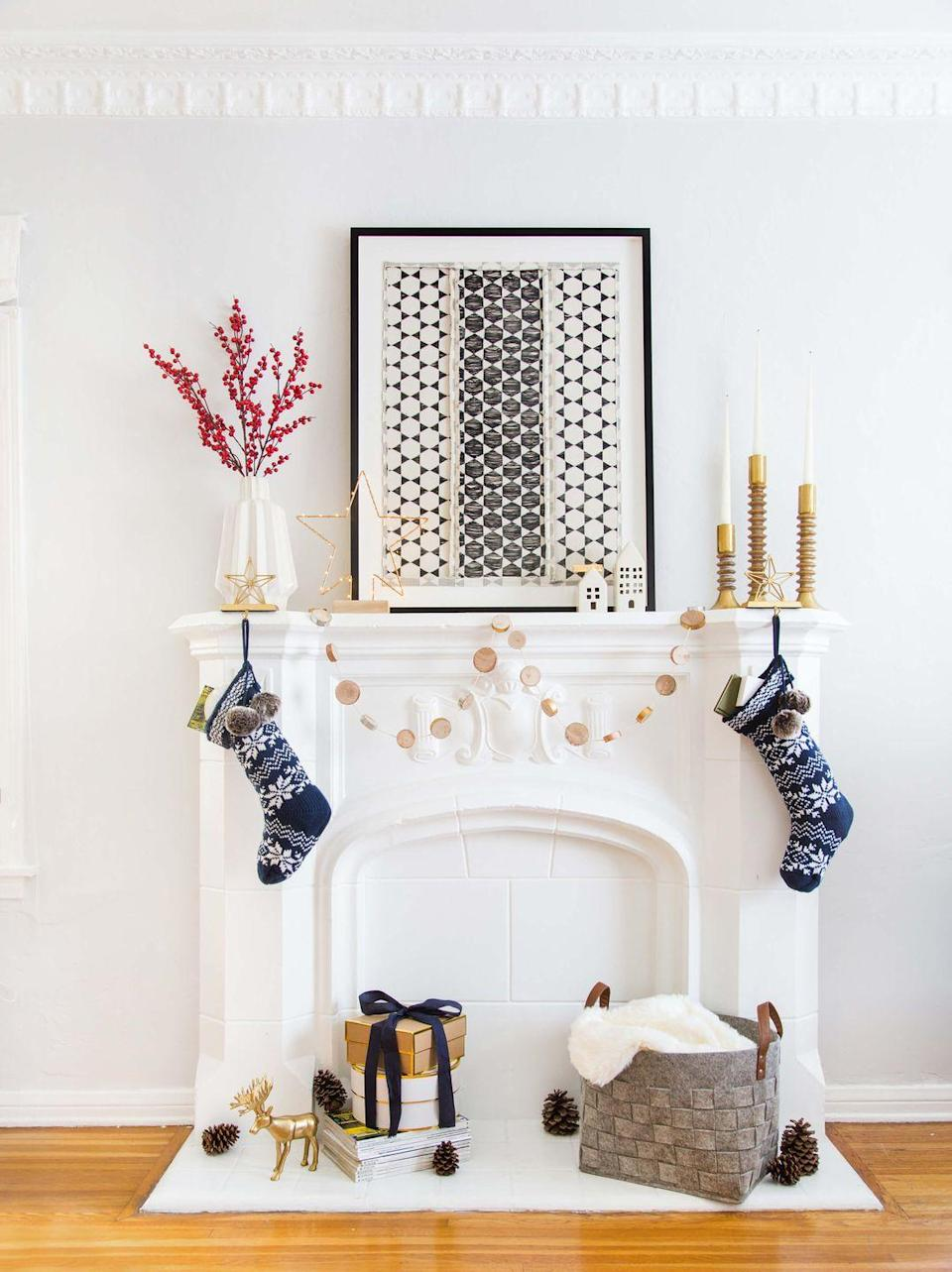 "<p>You don't have to stick to red and green for a festive mantel display. Keep your palette all white, then add in metallic accents. Gold feels celebratory, but still cool enough to not cramp your normal decor style. </p><p>See more at <a href=""https://stylebyemilyhenderson.com/blog/home-ginny-christmas"" rel=""nofollow noopener"" target=""_blank"" data-ylk=""slk:Emily Henderson"" class=""link rapid-noclick-resp"">Emily Henderson</a>.</p>"