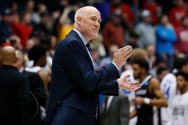 St. Bonaventure coach Mark Schmidt celebrates his team's First Four win over UCLA – the school's first in 48 years. (Getty)