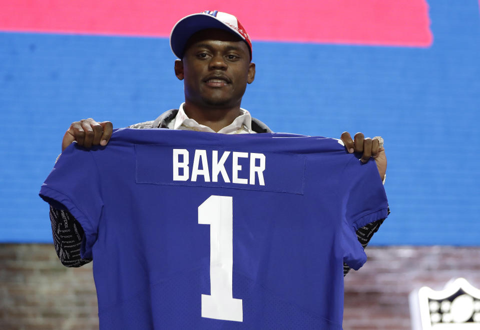 Deandre Baker after the Giants drafted him in the first round of the 2019 NFL draft. (AP Photo/Mark Humphrey, File)