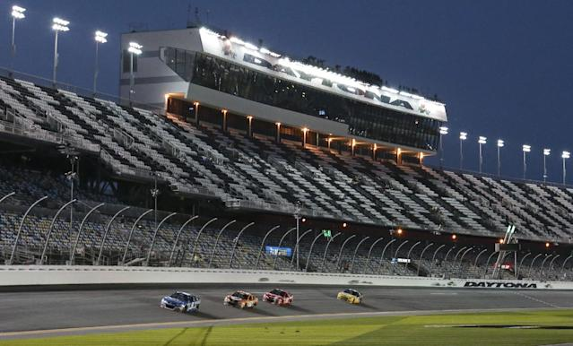 Kasey Kahne, Bobby Labonte, Justin Allgaier, and David Ragan, from left, drive along the front stretch during an evening practice for the Daytona 500 NASCAR Sprint Cup Series auto race at Daytona International Speedway in Daytona Beach, Fla., Wednesday, Feb. 19, 2014. (AP Photo/John Raoux)