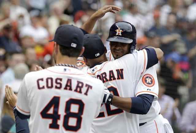 Houston Astros' Jesus Guzman, right, is congratulated by teammates after hitting a two-run home run in the first inning of a baseball game against the New York Yankees, Tuesday, April 1, 2014, in Houston. (AP Photo/Patric Schneider)