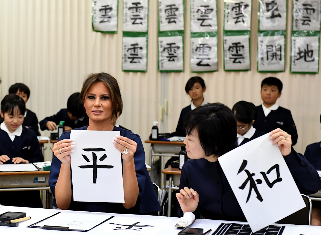 First Lady Melania Trump shows her calligraphy with Akie Abe, wife of Japanese prime minister, while attending a calligraphy class of 4th graders at the Kyobashi Tsukiji elementary school in Tokyo.
