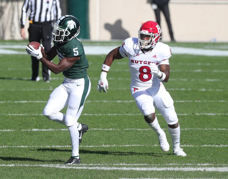 Michigan State wide receiver Jayden Reed makes a catch against Rutgers linebacker Tyshon Fogg on Saturday, Oct. 24, 2020, at Spartan Stadium.