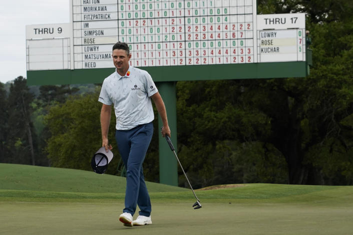 Justin Rose, of England, walks off the 18th hole with a seven-under par first round at the Masters golf tournament on Thursday, April 8, 2021, in Augusta, Ga. (AP Photo/David J. Phillip)