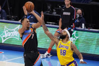 Oklahoma City Thunder forward Darius Bazley (7) shoots over Los Angeles Lakers forward Markieff Morris (88) during the first half of an NBA basketball game Wednesday, Jan. 13, 2021, in Oklahoma City. (AP Photo/Sue Ogrocki)