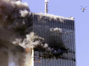 <p>The World Trade Center in New York City burns as a police helicopter flies nearby. (Reuters)</p>