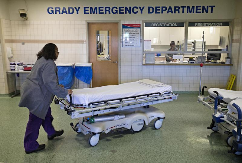In this Friday, Jan. 24, 2014 photo, a worker wheels beds through the emergency department at Grady Memorial Hospital, in Atlanta. In two years, federal payments to hospitals treating a large share of the nation's poor will begin to evaporate under the premise that more people than ever will have some form of insurance under the federal health care law. The problem is that many states have refused to expand Medicaid, leaving public safety net hospitals there in a potentially precarious financial situation and elected officials facing growing pressure to find a fiscal fix. And in an election year, Democrats are using the decision by Republican governors not to expand Medicaid as a major campaign issue and arguing the hospital situation could have been avoided. (AP Photo/David Goldman)