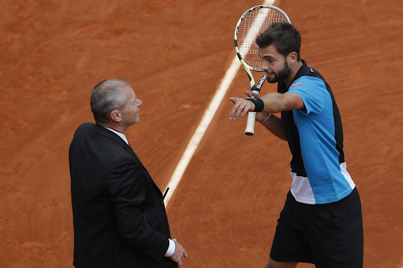 Benoit Paire of France, right, argues with an official in his third round match against Japan's Kei Nishikori at the French Open tennis tournament, at Roland Garros stadium in Paris, Saturday, June 1, 2013. Paire was given a penalty point. (AP Photo/Christophe Ena)