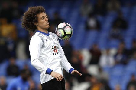 Chelsea's David Luiz warms up before the match