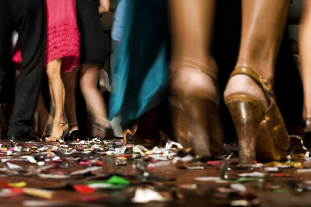 Wedding party, feet and legs of dancing people.
