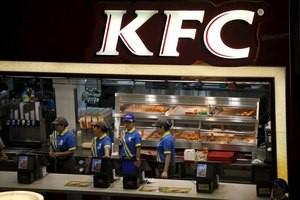 File photo of employees working at a KFC store in Shanghai