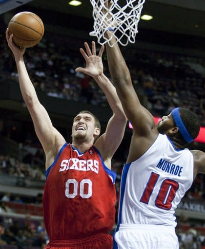 Philadelphia 76ers' Spencer Hawes (00) goes to the basket against Detroit Pistons' Greg Monroe (10) in the first half of an NBA basketball game on Thursday, April 26, 2012, in Auburn Hills, Mich. (AP Photo/Duane Burleson)
