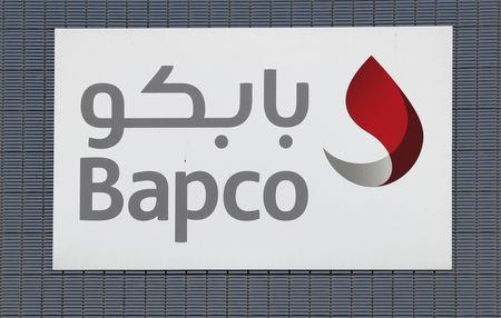 "The Corporate logo of Bahrain petroleum company ""Bapco"" is seen on a fence in Sitra, south of Manama"