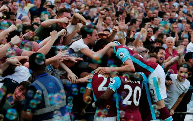<span>Cheik Kouyate celebrates his goal with the West Ham fans</span> <span>Credit: AFP </span>