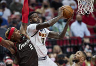 Denver Nuggets forward JaMychal Green shoots next to Portland Trail Blazers forward Rondae Hollis-Jefferson, left, during the first half of Game 6 of an NBA basketball first-round playoff series Thursday, June 3, 2021, in Portland, Ore. (AP Photo/Craig Mitchelldyer)
