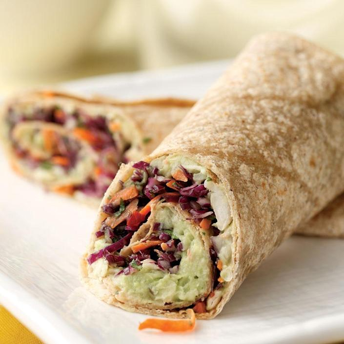 <p>White beans mashed with ripe avocado and blended with sharp Cheddar and onion makes an incredibly rich, flavorful filling for this wrap. The tangy, spicy slaw adds crunch. A pinch (or more) of ground chipotle pepper and an extra dash of cider vinegar can be used in place of the canned chipotles in adobo sauce. Wrap these up to take as a healthy and portable lunch for work.</p>