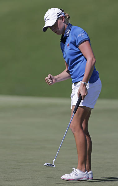 Stacy Lewis reacts after saving a par on the 11th hole during final round play in the Navistar LPGA Classic golf tournament, Sunday, Sept. 23, 2012, at the Robert Trent Jones Golf Trail in Prattville, Ala. (AP Photo/Dave Martin)
