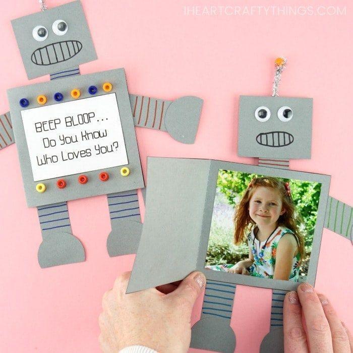 """<p>""""Beep, beep, beep"""" is a robot's way of saying """"I love you."""" In this case, a paper robot gives your dad a sweet surprise: a picture of his favorite human.</p><p><a href=""""https://iheartcraftythings.com/how-to-make-a-paper-robot.html"""" rel=""""nofollow noopener"""" target=""""_blank"""" data-ylk=""""slk:Get the tutorial at I Heart Crafty Things »"""" class=""""link rapid-noclick-resp""""><em>Get the tutorial at I Heart Crafty Things »</em></a></p>"""