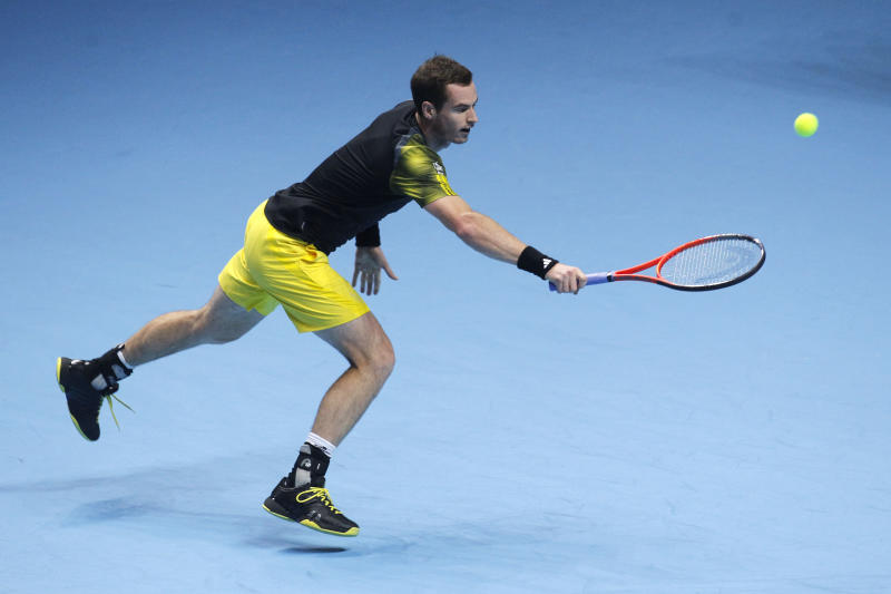 Andy Murray of Britain plays a return to Novak Djokovic of Serbia during their ATP World Tour Finals singles tennis match at the O2 Arena in London, Wednesday, Nov. 7, 2012. (AP Photo/Sang Tan)