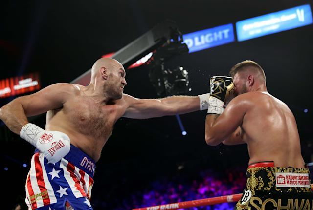 Tyson Fury (L) connects with a punch on Tom Schwarz during a heavyweight fight at MGM Grand Garden Arenaon June 15, 2019 in Las Vegas, Nevada. Fury won with a second-round TKO. (Steve Marcus/Getty Images)