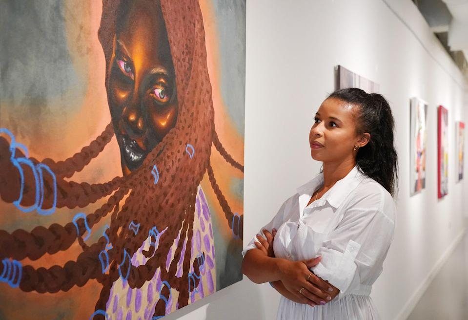A Hofa Gallery employee looks at 'Serena' by Chinaza Agbor (Jonathan Brady/PA) (PA Wire)