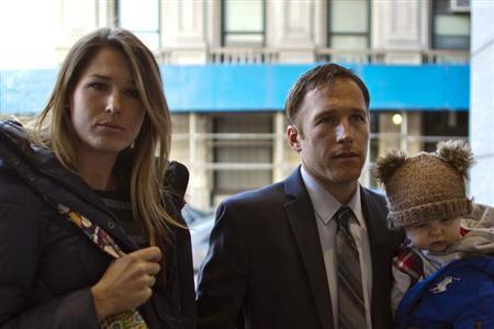 Olympic alpine skier Miller arrives with his wife Morgan and his son at Manhattan's Family Court in New York