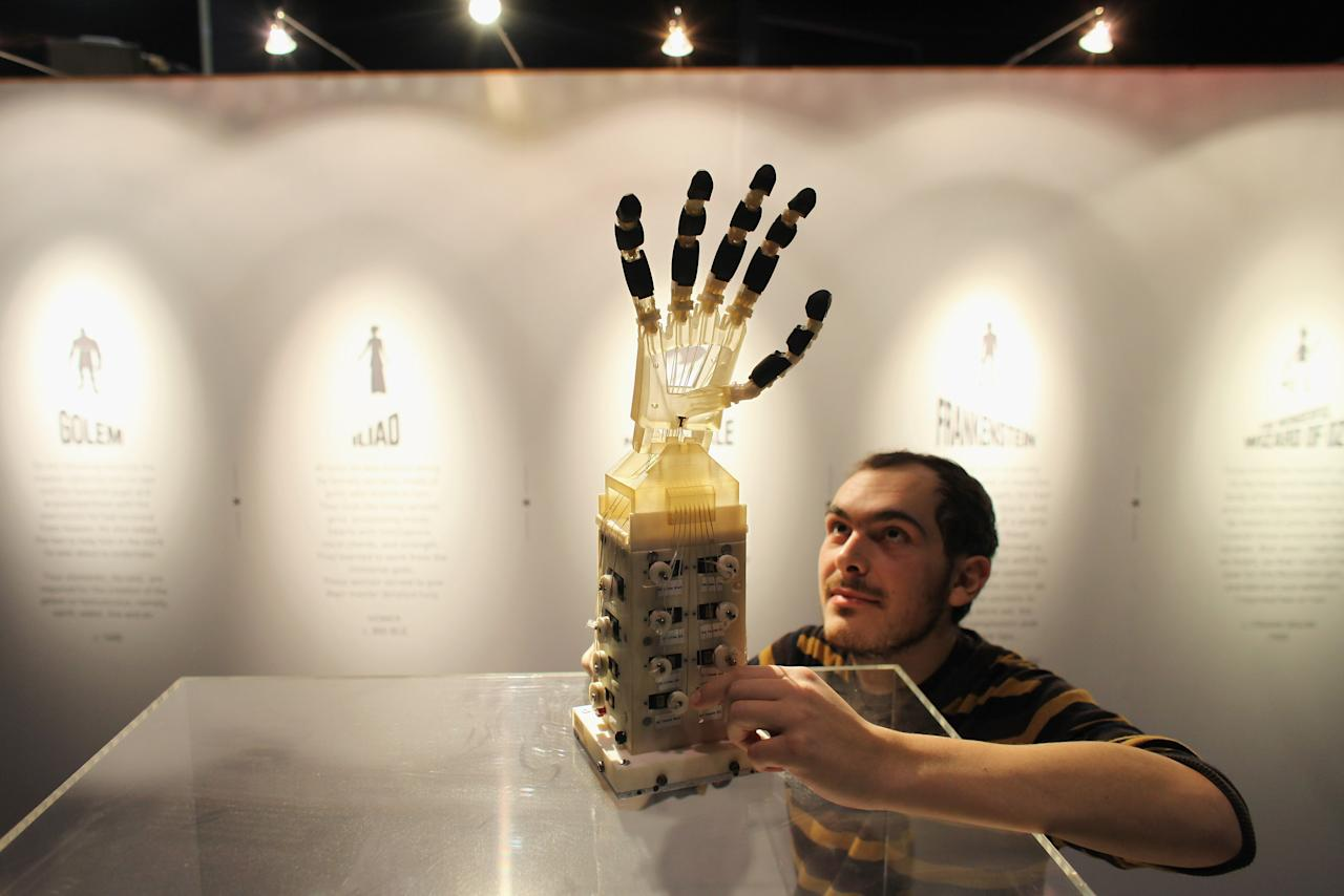 Robotics student Gildo Andreoni works on a Dexmart robotic hand built at the University of Bologna in the Robotville exhibition at the Science Museum on November 29, 2011 in London, England. (Photo by Oli Scarff/Getty Images)