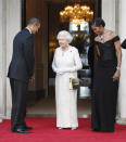 FILE - In this May 25, 2011 file photo, U.S. President Barack Obama and first lady Michelle Obama welcome Queen Elizabeth II for a reciprocal dinner at Winfield House in London. (AP Photo/Charles Dharapak, File)