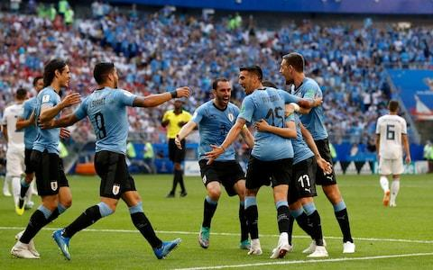 Uruguay's players celebrate the second goal of their team during the group A match between Uruguay and Russia at the 2018 soccer World Cup at the Samara Arena in Samara, Russia, Monday, June 25, 2018 - Credit: AP