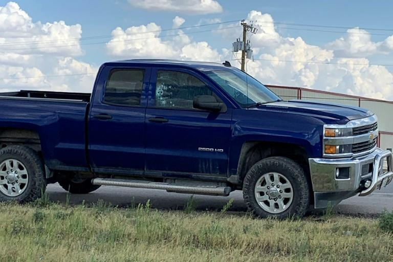 This handout image obtained courtesy of Ernst Villanueva taken on August 31, 2019 show a car with multiple bullet holes in the windows after a gunman opened fire on the I-20 highway between Odessa and Midland, Texas (AFP Photo/HO)
