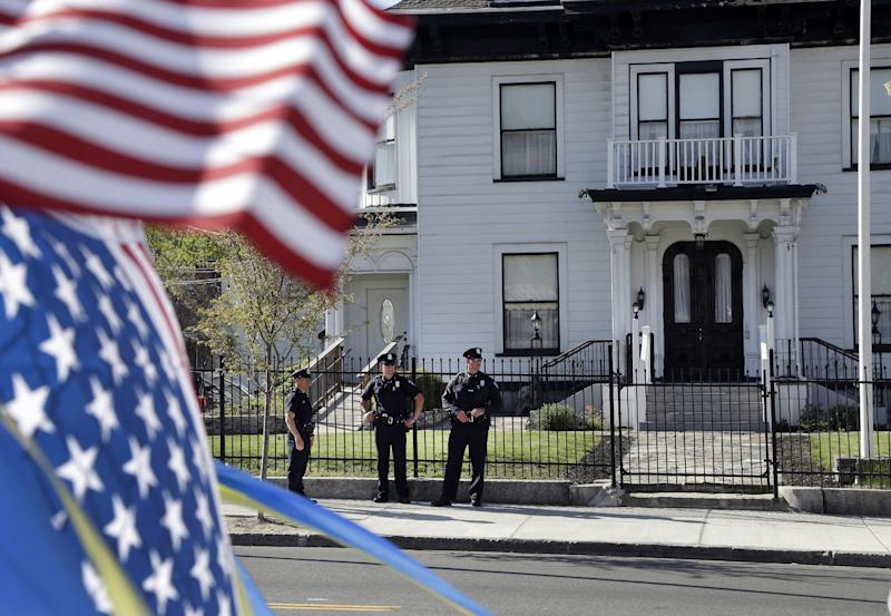 Police keep watch outside Graham, Putnam, and Mahoney Funeral Parlors in Worcester, Mass., Monday, May 6, 2013 where the body of killed Boston Marathon bombing suspect Tamerlan Tsarnaev is being prepared for burial. Funeral director Peter Stefan has pleaded for government officials to use their influence to convince a cemetery to bury Tsarnaev, but so far no state or federal authorities have stepped forward. (AP Photo/Elise Amendola)
