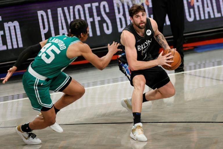 Joe Harris of the Brooklyn Nets drives to the basket against Boston's Romeo Langford in the Nets' 130-108 NBA playoff victory over the Celtics