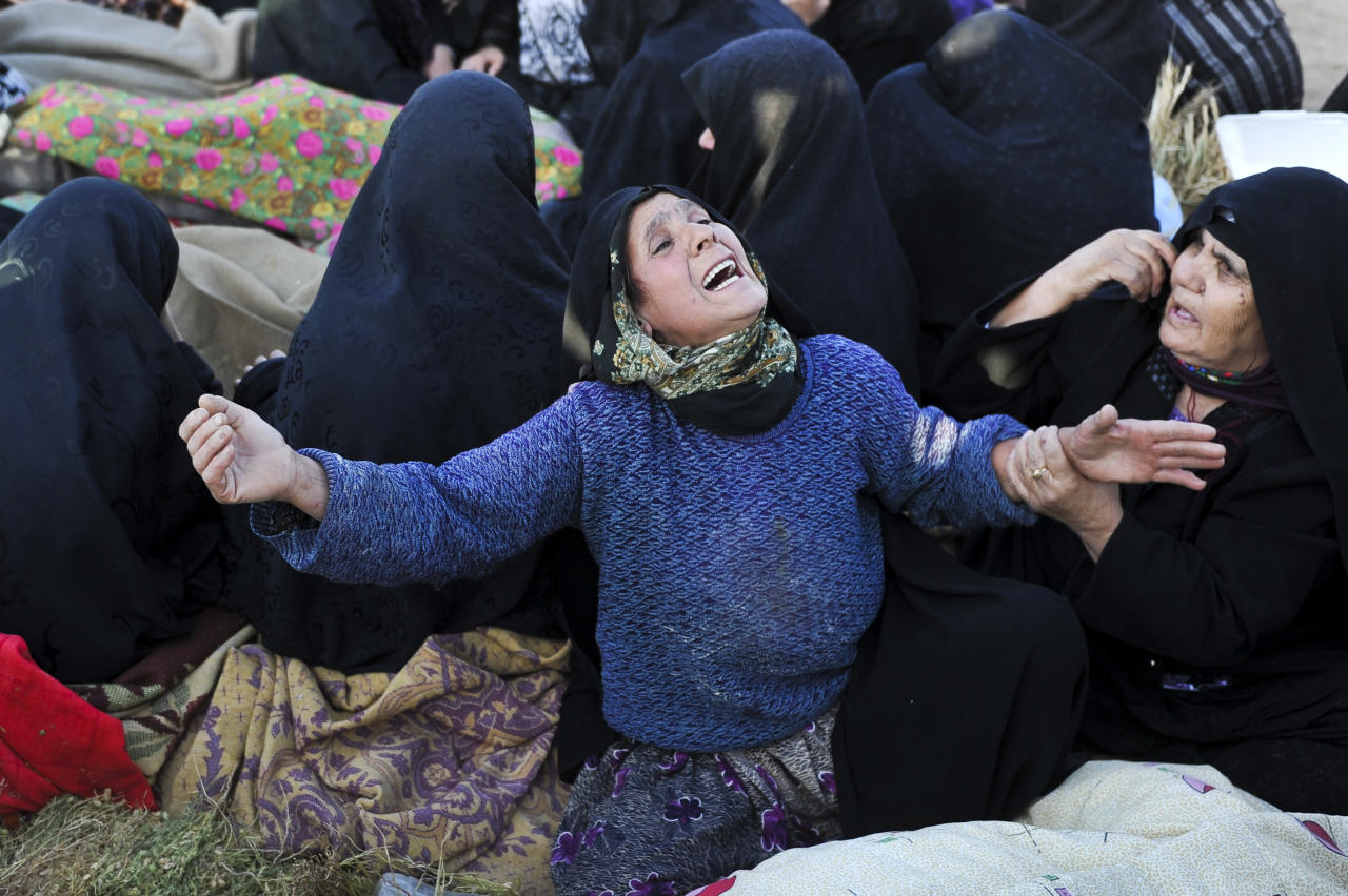 An Iranian woman grieves after her loved ones were killed during Saturday's earthquake at the village of Bajebaj near the city of Varzaqan in northwestern Iran, Sunday, Aug. 12, 2012. Twin earthquakes in Iran have killed at least 250 people and injured over 2,000, Iranian state television said on Sunday, after thousands spent the night outdoors after their villages were leveled and homes damaged in the country's northwest. Iran is located on seismic fault lines and is prone to earthquakes. It experiences at least one earthquake every day on average, although the vast majority are so small they go unnoticed. (AP Photo/ISNA, Arash Khamoushi)